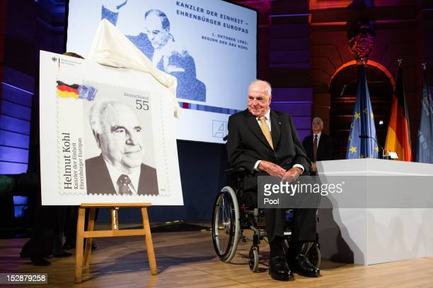 The former German Chancellor Helmut Kohl looks at a commemorative postal stamp showing himself at a gala evening in Kohl's honour at the Deutsches...