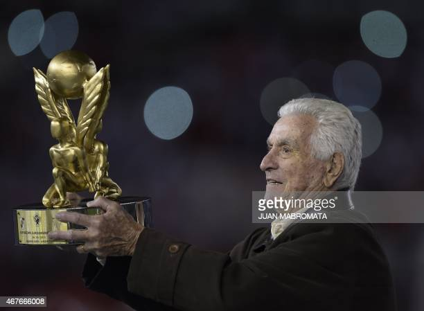 The former goalkeeper of Argentina's football team River Plate Amadeo Carrizo holds the EuroAmerican Super Cup trophy before the start of the match...