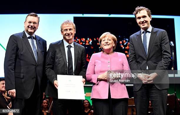 The former head coach of the German National and current head coach of the US Soccer National Team Juergen Klinsmann , DFB president Reinhard Grindel...