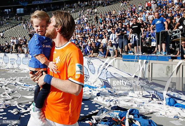 The former Hertha player Peter Niemeyer of Darmstadt kisses his son after visiting the Hertha fans after the Bundesliga match between Hertha BSC and...