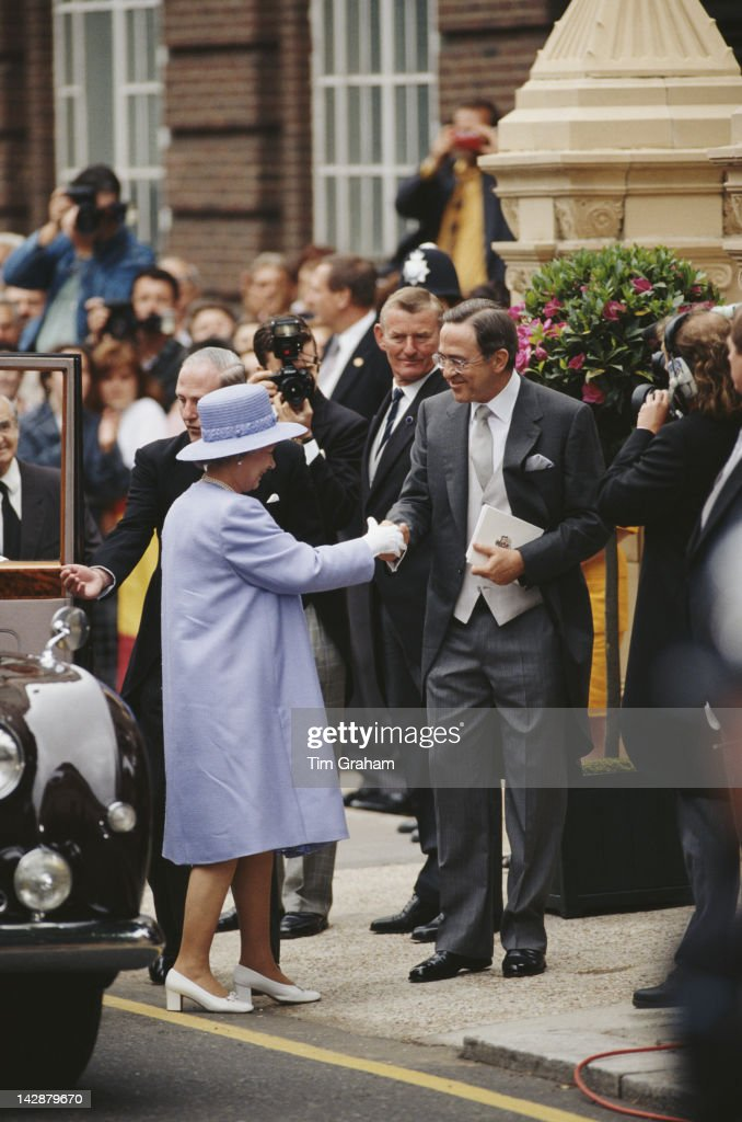 The former King Constantine II of Greece welcomes Queen Elizabeth II to the wedding of his son Crown Prince Pavlos and Marie-Chantel Miller at St Sophia's Cathedral, Bayswater, London, 1st July 1995.