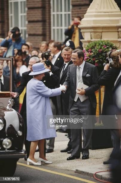 The former King Constantine II of Greece welcomes Queen Elizabeth II to the wedding of his son Crown Prince Pavlos and MarieChantel Miller at St...