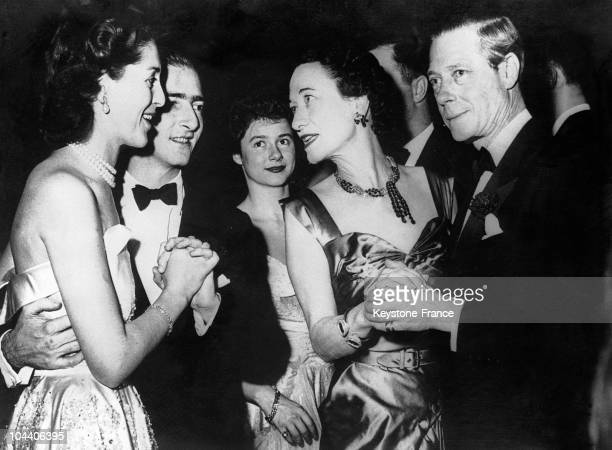 The former King PIERRE of Yugoslavia and Queen ALEXANDRA conversing with the Duke and Duchess of WINDSOR while dancing at a bal held in New York for...