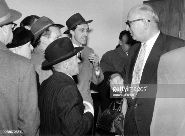 The former lieutenant general of the combat units of the SS Max Simon is congratulated by friends on the acquittal while leaving the courtroom on 23...