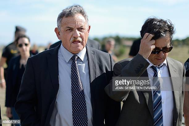 The former mayor of La FautesurMer Rene Marratier with his lawyer Didier Seban walks on September 25 2014 in La FautesurMer western France as the...