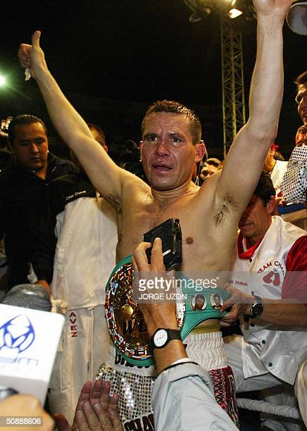The former Mexican champion Julio Cesar Chavez celebrates after beating American Frankie Randall by points in Chavez's farewell fight in Mexico City...