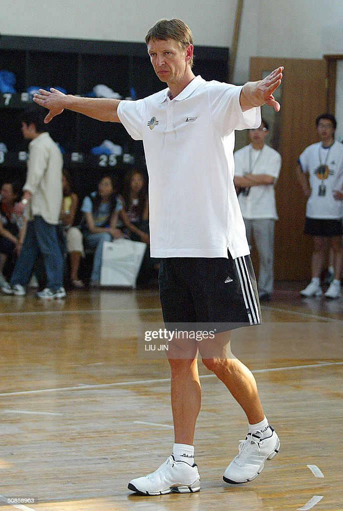 The former NBA star Detlef Schrempf gestures in a training session of the Adidas Basketball Superstar Camp in Shanghai, 20 May 2004. The camp features NBA players and professional coaches from the US, Europe and China to develop future generations of Basketball superstars. Fifty elite youth basketball players from China, Hong Kong, Australia, Philippines, Korea, Chinese Taipei, Singapore participate the four-day training event. AFP PHOTO/LIU Jin
