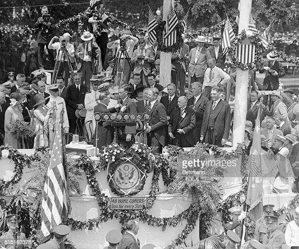 The former President Calvin Coolidge is shown decorating Charles A. Lindbergh, after his transatlantic flight, in Washington, D. C. On June 13, 1927....