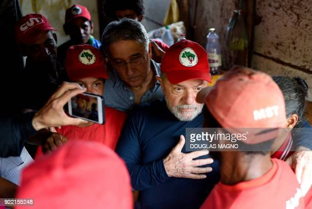The former president of Brazil Luiz Inacio Lula da Silva chats with a member of the Landless Workers Movement at the municipality of Itatiaiucu...
