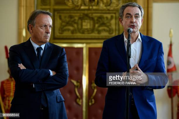 The former president of Spanish government Jose Luis Rodriguez Zapatero speaks to the press next to the former president of the French Senate...