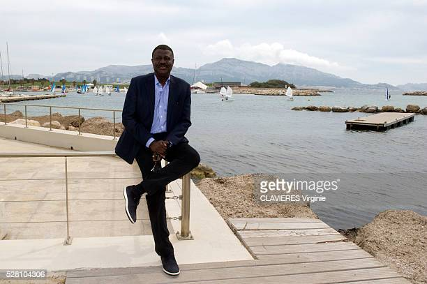 the former president of the football olympic club Marseille Pape Diouf is photographed for Paris Match on april 22 2016 in Marseille France