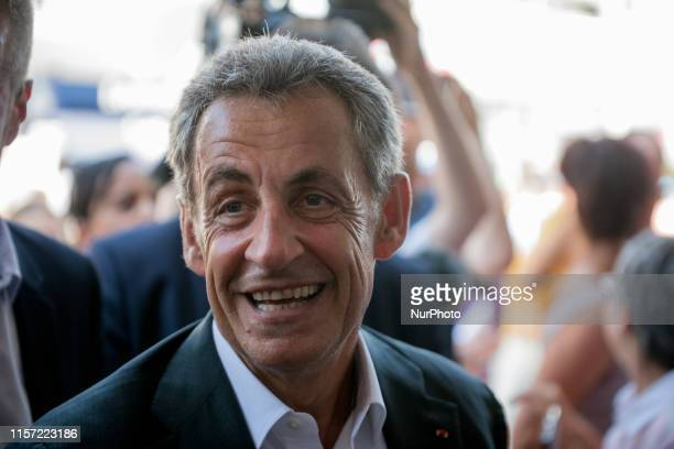 """The former President of the French Republic Nicolas Sarkozy presents his book """"Passions"""" in La Baule on July 22, 2019"""