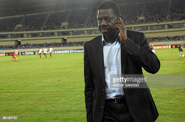 The former president of the Olympique de Marseille football team Pape Diouf speaks on the phone on January 24 2010 at the Chiazi stadium in Cabinda...