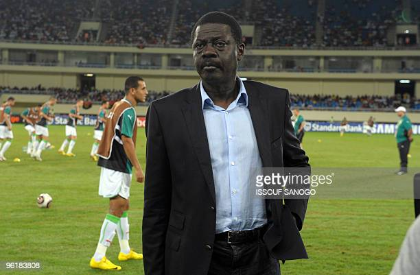 The former president of the Olympique de Marseille football team Pape Diouf arrives on January 24 2010 at the Chiazi stadium in Cabinda to watch the...