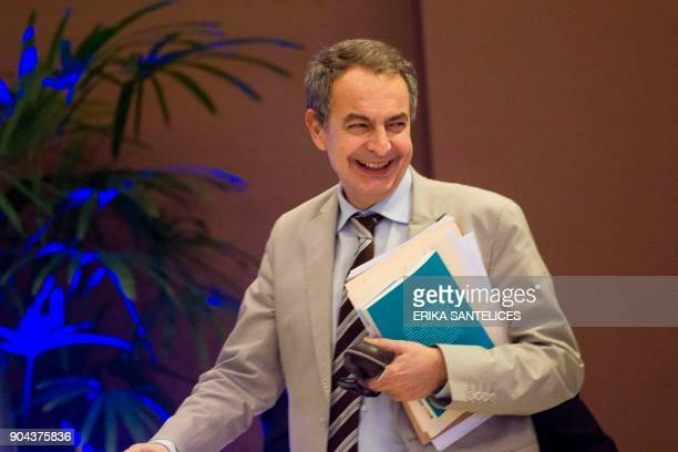 The former president of the Spanish government Jose Luis Rodriguez Zapatero smiles after a meeting between the Venezuelan government representatives...