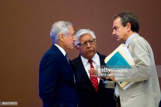 The former president of the Spanish government Jose Luis Rodriguez Zapatero and Chile's Foreign Minister Heraldo Munoz speak after a meeting between...