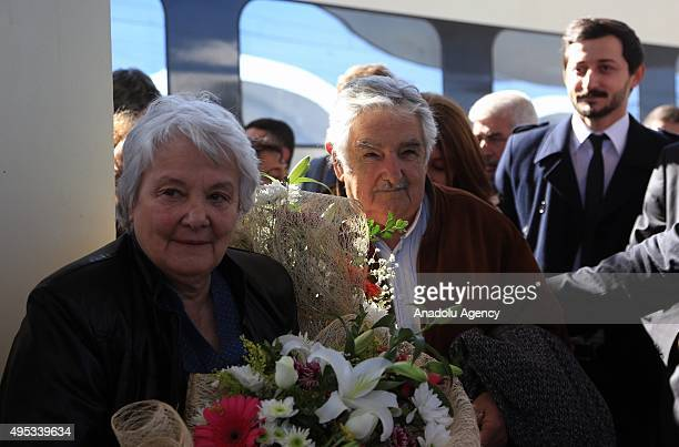 The former president of Uruguay Jose Mujica and his wife Lucia Topalansky an Uruguayan senator are welcomed with flowers as they arrive in Eskisehir...