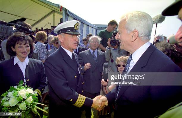 The former president Richard von Weizsäcker in a conversation with captain Immo von Schnurbein just before the christening of the cruise liner...
