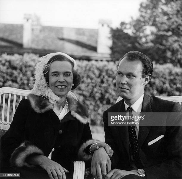 The former Queen of Italy Maria Jose of Savoy sitting in a garden with her son Victor Emmanuel November 1967