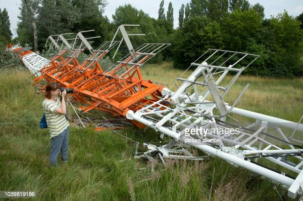 The former RIAS radio transmitter is inspected by journalists shortly after it was brought down in a controlled detonation in Berlin Germany 18 July...