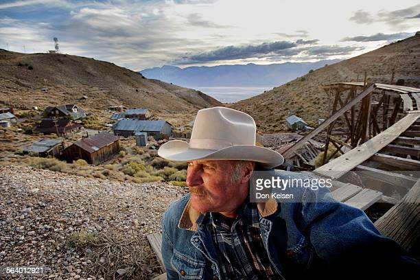 – – The former rip–roaring 1870s silver town – Cerro Gordo – is fighting to stay alive Owner/caretaker Mike Patterson seen here with his property...