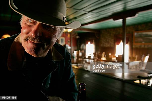 – – The former rip–roaring 1870s silver town – Cerro Gordo – is fighting to stay alive Owner/caretaker Mike Patterson seen here at the bar in the...