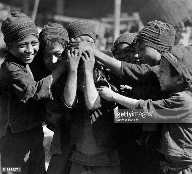 The former state Siam Group of young Siam boys playing together ca 1937 Photographer Hugo Adolf Bernatzik Published by 'Berliner Illustrirte Zeitung'...