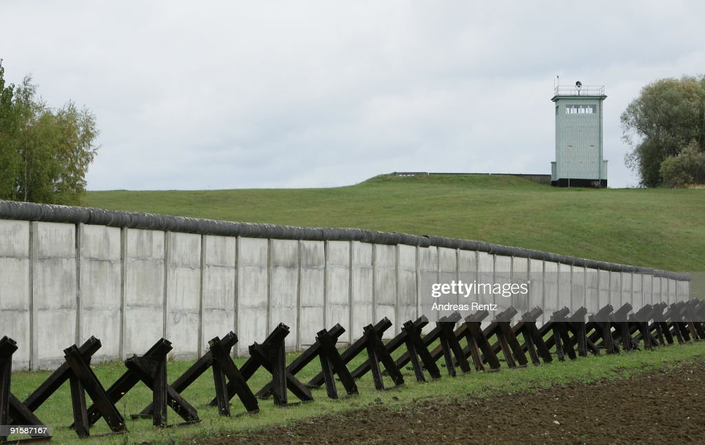 The former system of boundaries of the former German Democratic Republic (GDR) in the original condition is pictured on October 7, 2009 in Hoetensleben, near Marienborn, Germany. At a length of 350 meters and a surface area of 6.5 hectares include the term blend wall, the signal fence, the perspective and field of fire with light strip, patrol and vehicle barrier, the border wall and the guide tower with vehicle position remained. Particularly impressive is the course of the barrier at this point because they were built directly behind the houses of the village. Germany will celebrate the 20th anniversary of the fall of the Berlin Wall, which preceded the end of communist rule across Eastern Europe, on November 09, 2009.