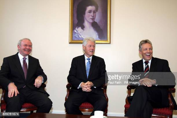 The former US President Bill Clinton with Northern Ireland First Minister Peter Robinson and Deputy First Minister Martin McGuinness , meet at the...