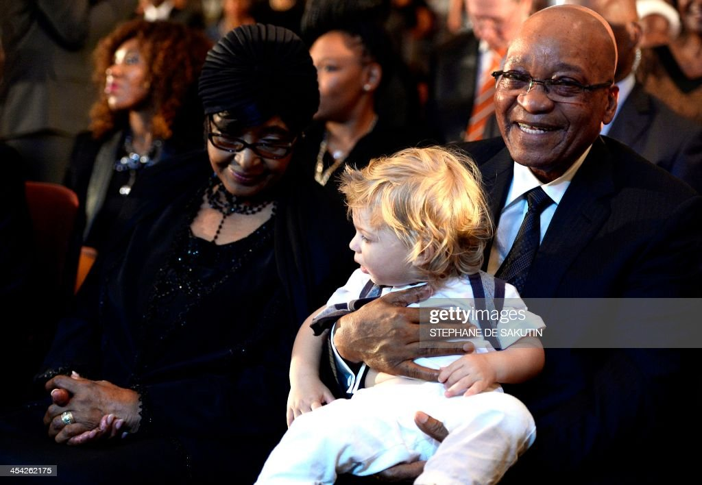 The former wife of Nelson Mandela, anti-apartheid campaigner Winnie Mandela Madikizela (L), and South African President Jacob Zuma attend a mass in memory of late South African President's Nelson Mandela on December 8, 2013 in Johannesburg. The revered icon of the anti-apartheid struggle in South Africa and one of the towering political figures of the 20th century, died in Johannesburg on December 5 at age 95. Mandela, who was elected South Africa's first black president after spending nearly three decades in prison, had been receiving treatment for a lung infection at his Johannesburg home since September, after three months in hospital in a critical state. AFP PHOTO / STEPHANE DE SAKUTIN / AFP PHOTO / Stéphane DE