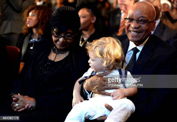 The former wife of Nelson Mandela antiapartheid campaigner Winnie Mandela Madikizela and South African President Jacob Zuma attend a mass in memory...