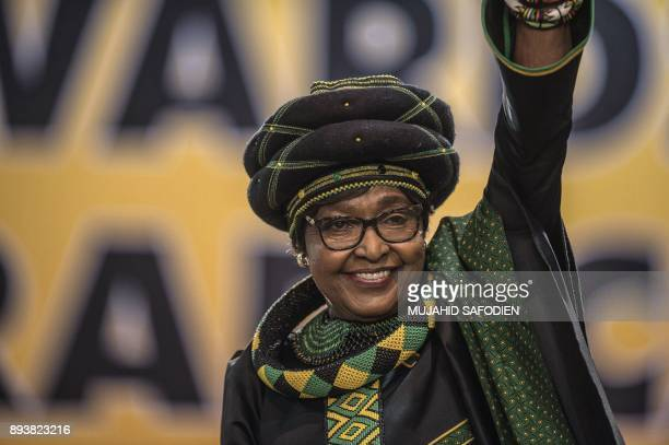 The former wife of the late South African President Nelson Mandela antiapartheid campaigner Winnie Mandela waves as she attends the 54th ANC National...