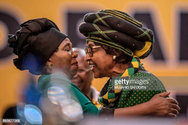 The former wife of the late South African President Nelson Mandela antiapartheid campaigner Winnie Mandela greets the candidate for the African...