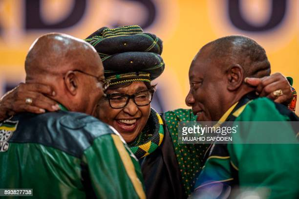 The former wife of the late South African President Nelson Mandela Winnie Mandela hugs South African President Jacob Zuma and Deputy President Cyril...