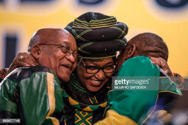 The former wife of the late South African President Nelson Mandela antiapartheid campaigner Winnie Mandela hugs South African President Jacob Zuma...