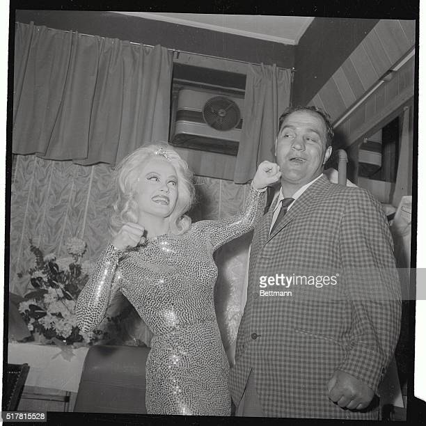 The former World Heavyweight Boxing Champ Rocky Maricano is caught with a left jab playfully thrown by film star Mamie Van Doren backstage at the...
