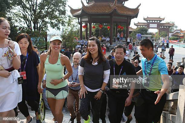 The former WTA player Li Na of China with Martina Hingis of Switzerland during the Yellow Crane Tower event on Day 2 of 2015 Dongfeng Motor Wuhan...