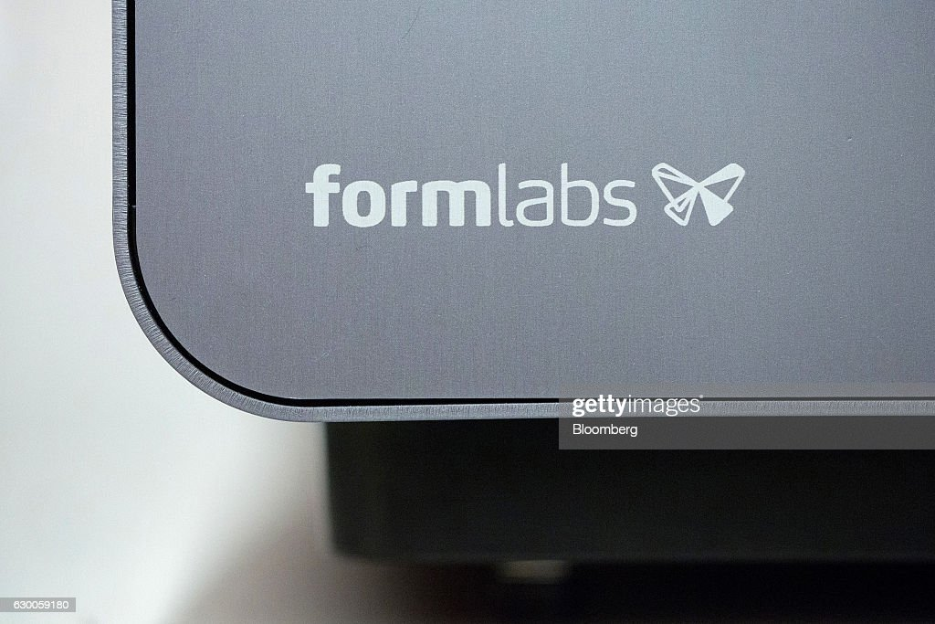 The Formlabs logo sits on a 3-D printing machine inside the offices of 3-D printing and design company Formlabs GmbH in Berlin, Germany, on Tuesday, Nov. 8, 2016. The 3-D printing process can cut down the time and effort in crafting desired products, while expanding design possibilities that may be too intricate for human hands. Photographer: Krisztian Bocsi/Bloomberg via Getty Images