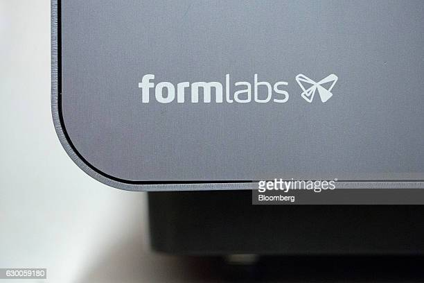 The Formlabs logo sits on a 3D printing machine inside the offices of 3D printing and design company Formlabs GmbH in Berlin Germany on Tuesday Nov 8...