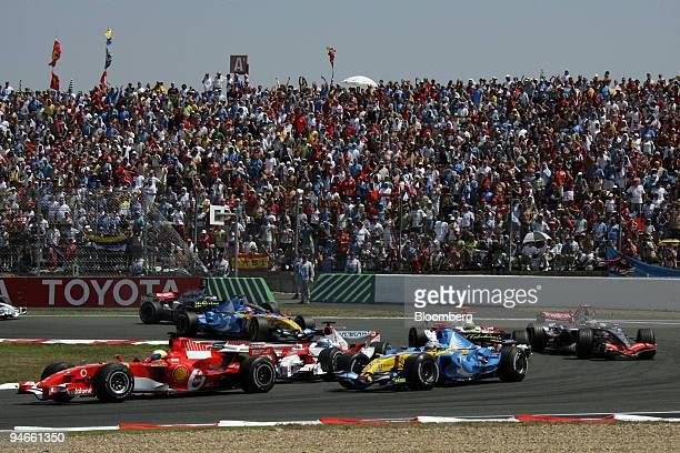 The Formula 1 GP is seen soon after the start in Magny Cours France Sunday July 16 2006 Ferrari's Michael Schumacher won Formula One's French Grand...
