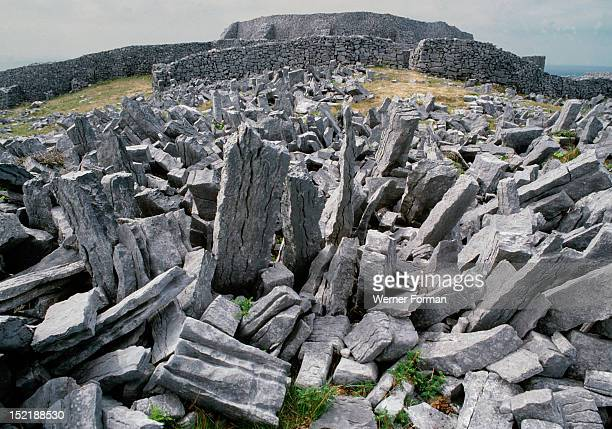 The Fort of Dun Aengus on the Isle of Inishmore Said to have been built by the mythical race the Fir Bholg The stones in the foreground are part of a...