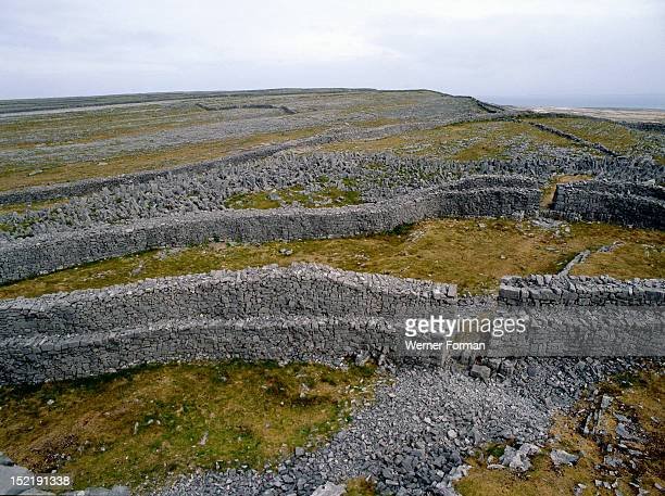 The Fort of Dun Aengus on the Isle of Inishmore Said to have been built by the mythical race the Fir Bholg View from inside the walls The stones in...