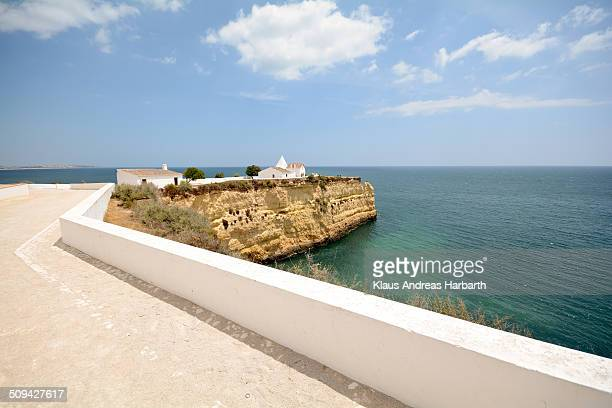 The Fort of Nossa Senhora da Rocha is a medieval castle situated in the civil parish of Porches, in the municipality of Lagoa in Portuguese Algarve....