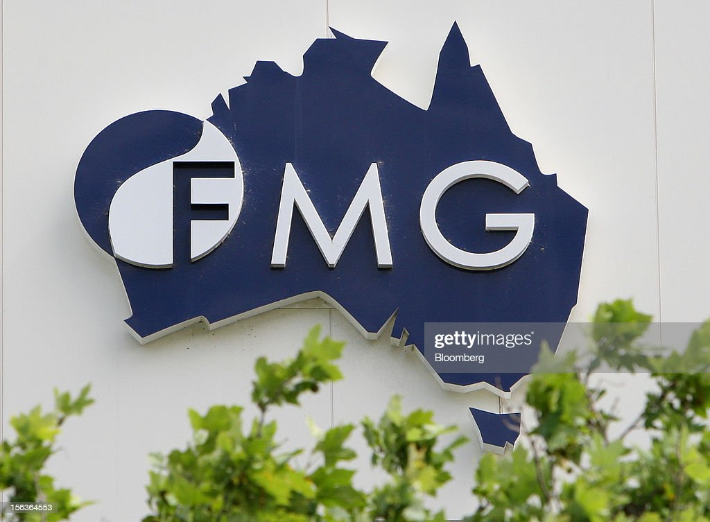 The Fortescue Metals Group Ltd. logo is displayed at the company's headquarters in Perth, Australia, on Wednesday, Nov. 14, 2012. Andrew Forrest, founder of Fortescue Metals, last month defeated a regulator's claim that he misled shareholders of the iron-ore exporter which made him Australia's fourth-richest person. Photographer: Sergio Dionisio/Bloomberg via Getty Images