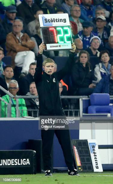 The forth referee Robert Schroeder shows a substitution with the substitution board during the Bundesliga match between FC Schalke 04 and FC Bayern...