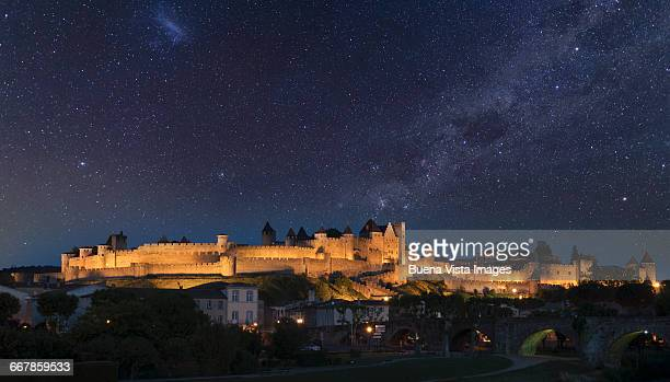 the fortified city of carcassonne at night. - 世界遺産 ストックフォトと画像