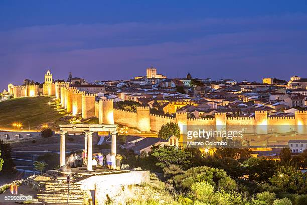 The fortified town of Avila and its walls at night