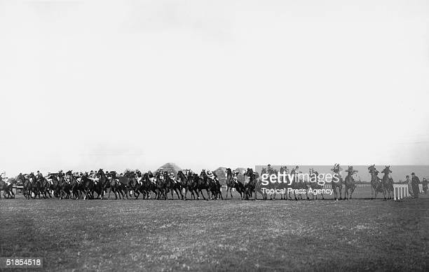 The forty runners line up at the start of the Beckhampton Stakes at Newbury race course, Berkshire, 8th April 1932.