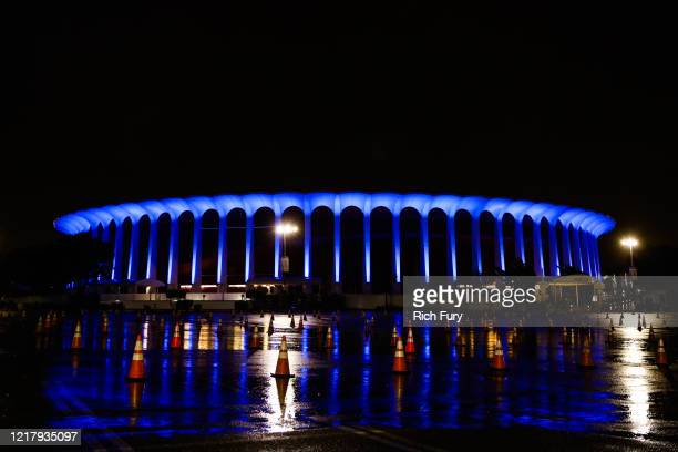 The Forum is illuminated in blue lights as part of the #LightItBlue for Health Workers movement on April 09, 2020 in Inglewood, United States....
