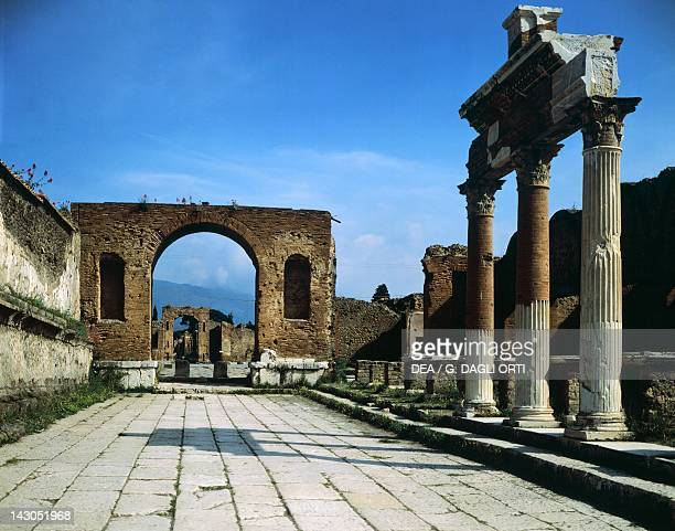 The Forum showing the entrance of Macellum on the right and in the background the Arch of Triumph Pompeii Campania Roman Civilization 1st Century